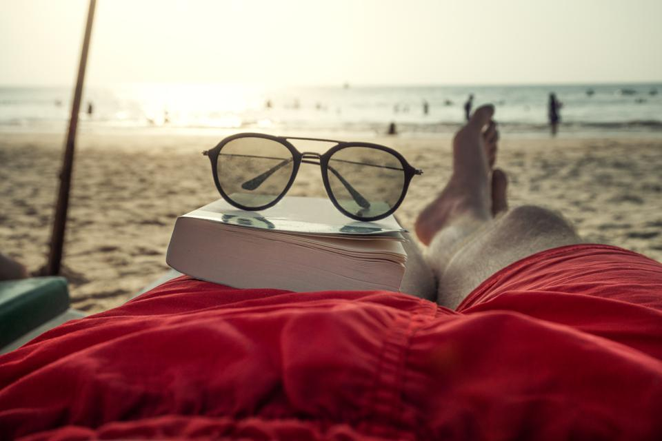 Uncover The Secrets Of Money With This Summer Reading List
