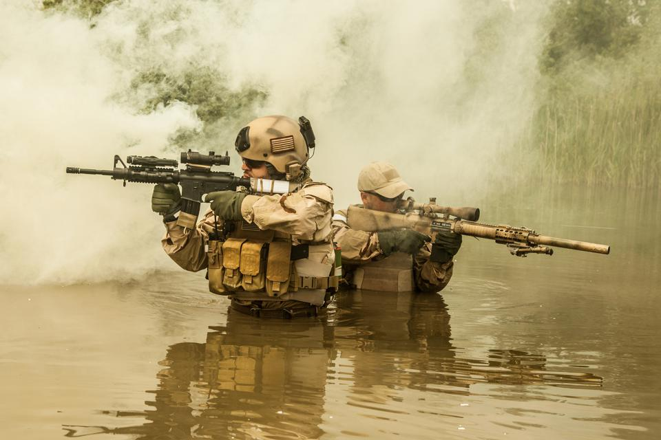 A Navy Seal Exits The Water Armed Photograph by Michael Wood  |Navy Seals Emerging From Water