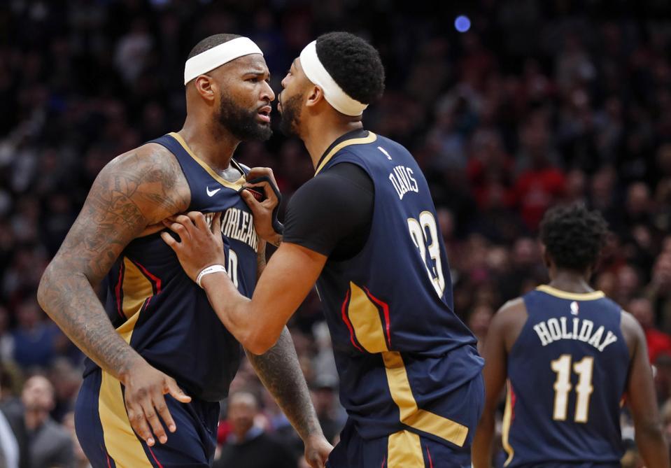 New Orleans Pelicans forward Anthony Davis restrains DeMarcus Cousins.