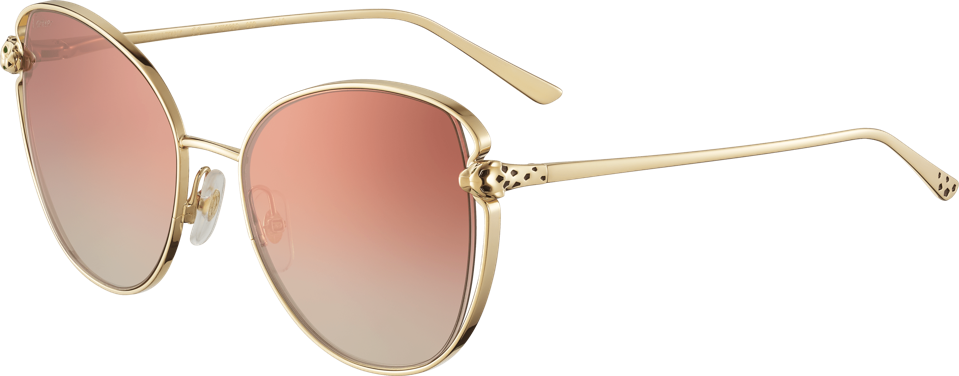 Panthère de Cartier sunglasses, smooth golden-finish metal, graduated burgundy lenses, golden-finish panther heads with black lacquer spots and green lacquer eyes, $1,395. Available at Cartier boutiques nationwide. For more information please visit www.cartier.com or contact 1-800-CARTIER.