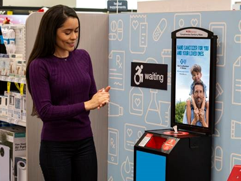 Terraboost Media hand-sanitizing kiosk at a CVS pharmacy. The kiosk dispense wipes along with advertising messages.