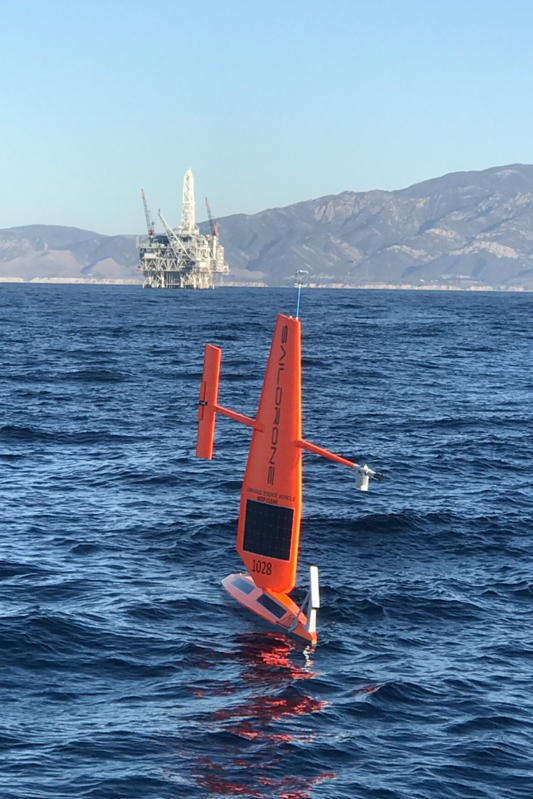 Exxon oil detSaildrone in front of ExxonMobil's Hondo Platform in Santa Barbara, California.  Saildrones can be used to detect oil spills on the surface of the ocean.ection