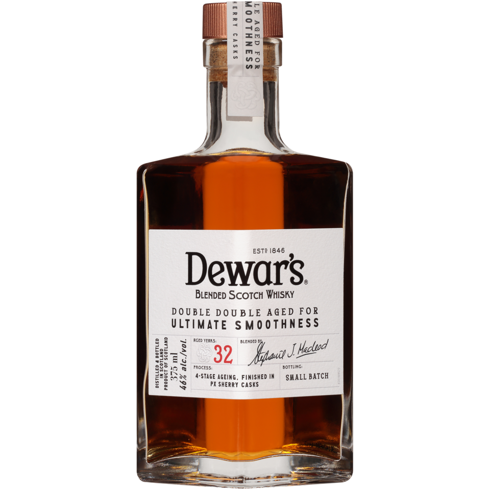 A closeup of a bottle of Dewar's 32 year old blended scotch, with a mahogany color