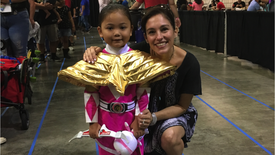 Amy Jo Johnson at a convention with a Pink Power Ranger young fan.