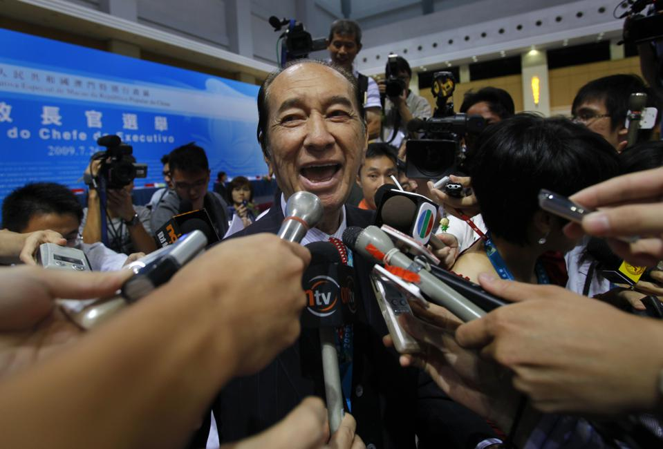 In this photo taken on July 26, 2009, Macau tycoon Stanley Ho, talks to reporters after the Macau chief executive election in Macau. Casino mogul Ho, the father of Macau's fabled gambling industry, has been hospitalized in Hong Kong, local newspapers reported Tuesday, Aug. 4, 2009. (AP Photo/Vincent Yu)