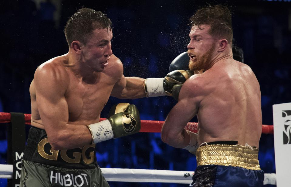 Gennady Golovkin, right, connects with a right to Canelo Alvarez during a  middleweight title