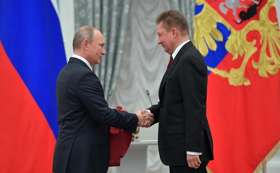 Vladimir Putin with Gazprom CEO Alexei Miller during an awards ceremony on November