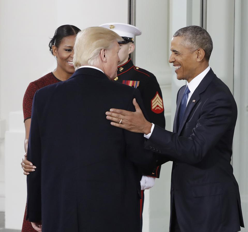 Americas consequential and therefore more divided year and what president barack obama and first lady michelle obama greet president elect donald trump at the white house in washington friday jan 20 2017 m4hsunfo