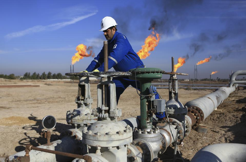 Worker operating valves in an oilfield in Basra in Iraq.