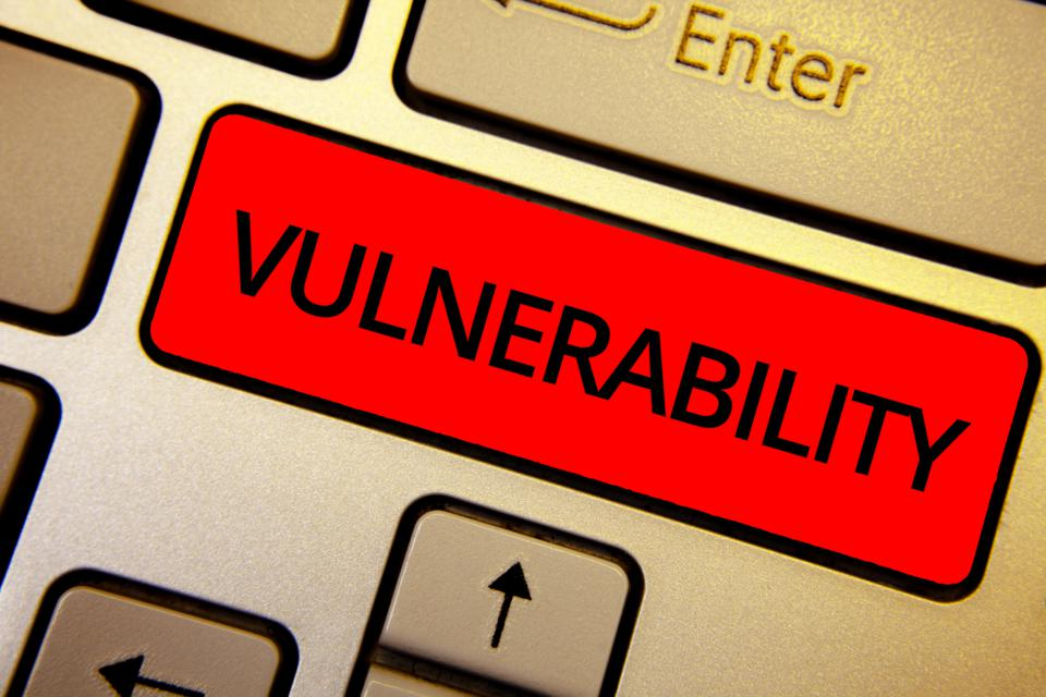 Red key saying 'vulnerability' on a close-up image of part of a keyboard