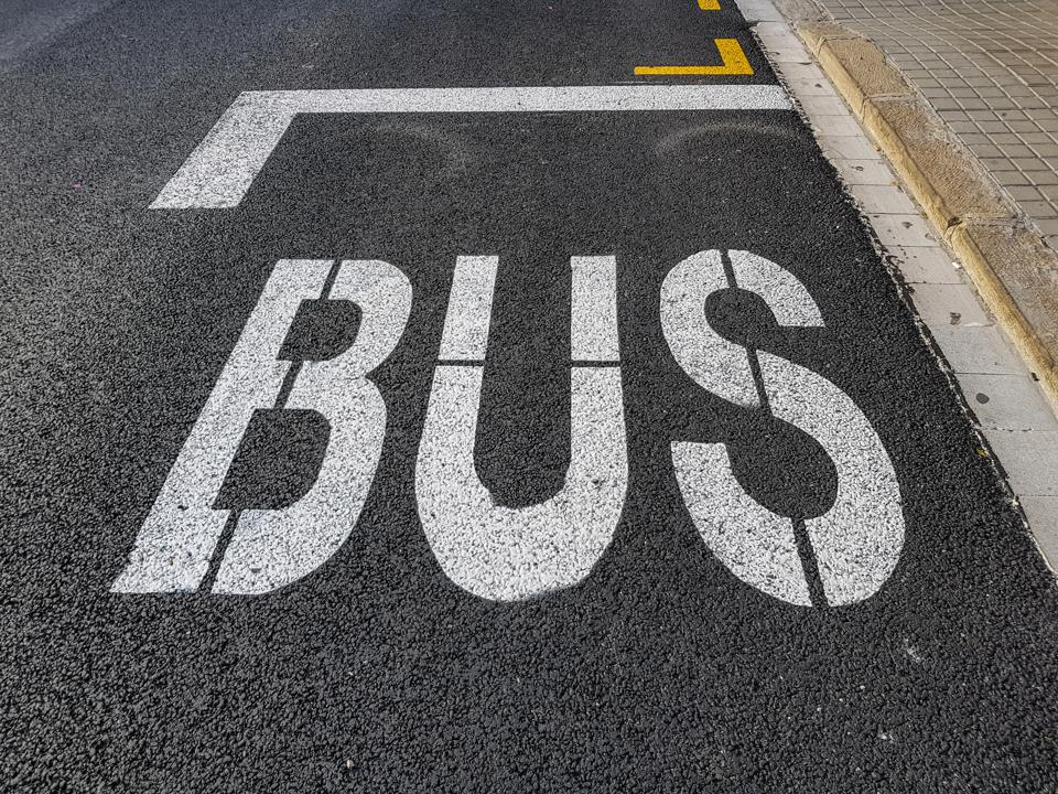 Painted inscription BUS on the road surface
