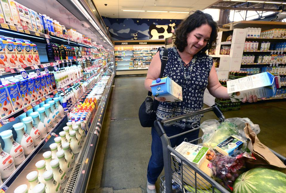 Shoppers discover plant-based milks in the dairy section.