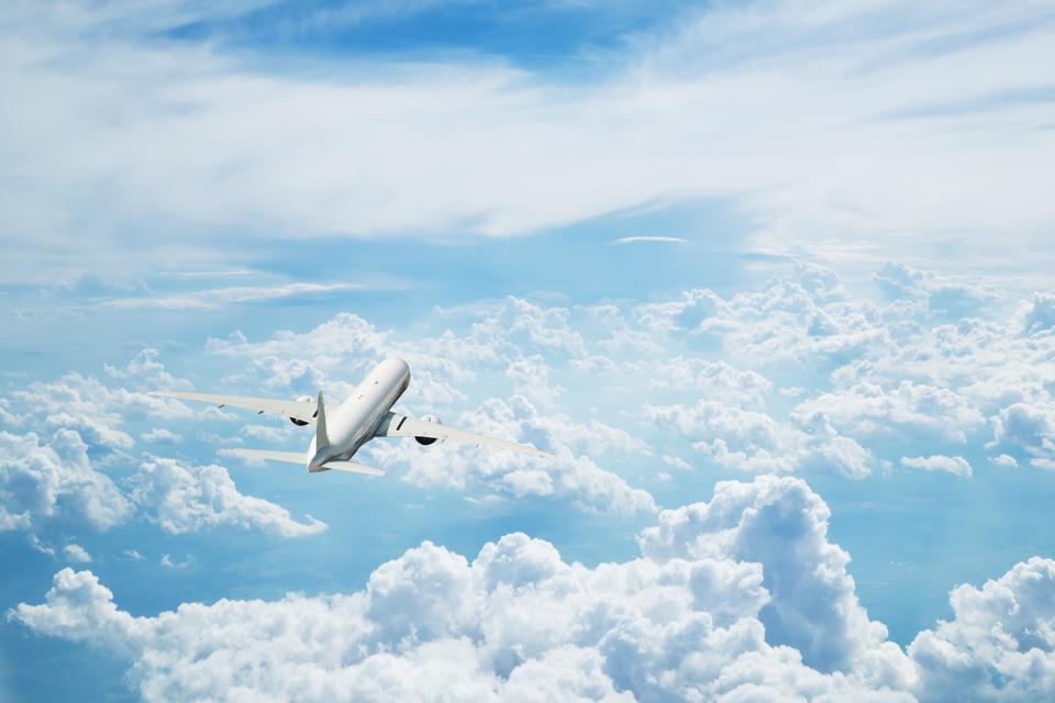 Commercial airplane flying above clouds. Is now the time for an airline passengers' bill of rights?
