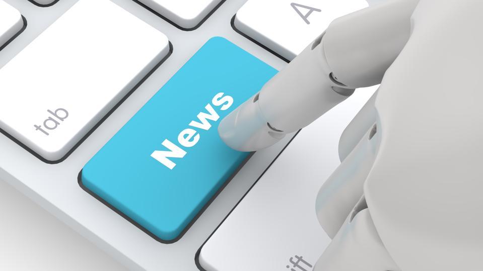 Robot hand touching News key on pc keyboard,