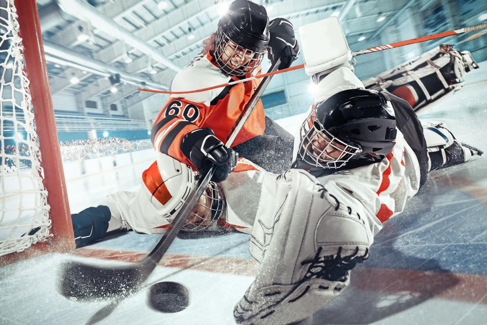 The ice hockey sport female players in action, motion, movement. Sport comptetition concpet, girls on training or game at arena