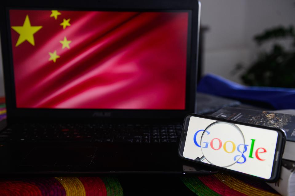 Google logo is seen on a Huawei smart phone with China's