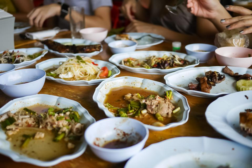 Leftover food after a meal at a restaurant. Food waste is a huge and growing environmental, financial and social problem globally.