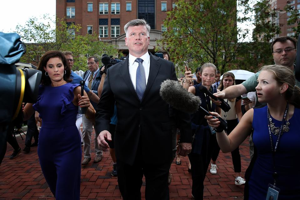 Kevin Downing (C), Manafort's attorney, talks with reporters after the jury found Manafort guilty on eight counts of fraud.