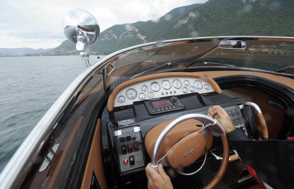 A Riva employee test drives a boat at th
