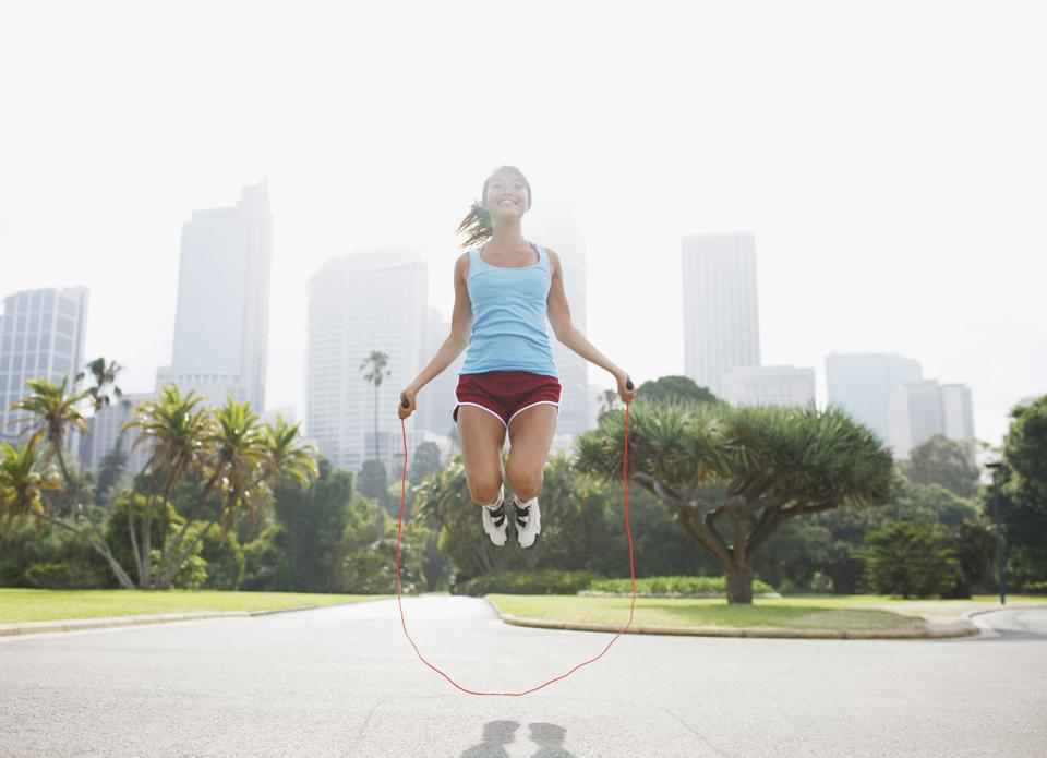 Woman skipping rope in park