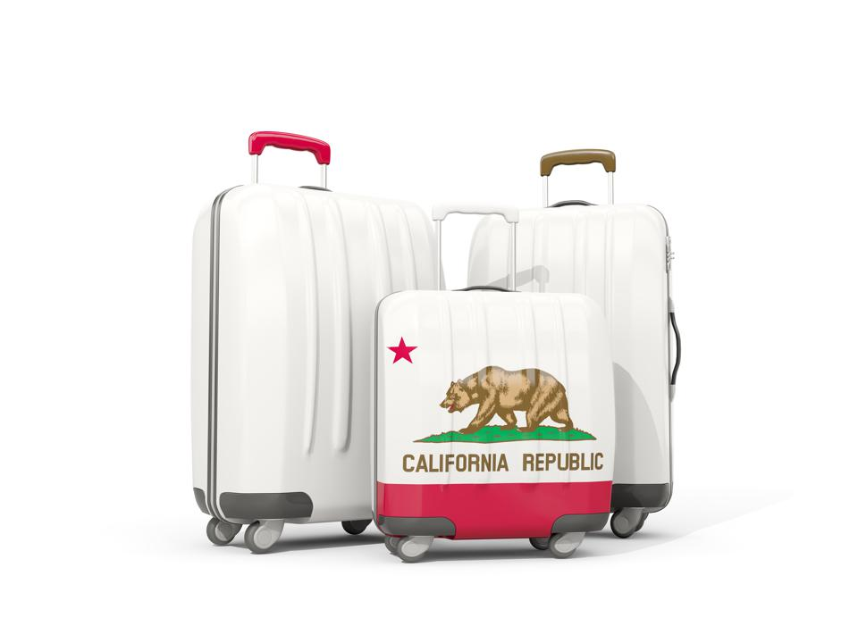 Luggage with flag of california. Three bags with united states local flags