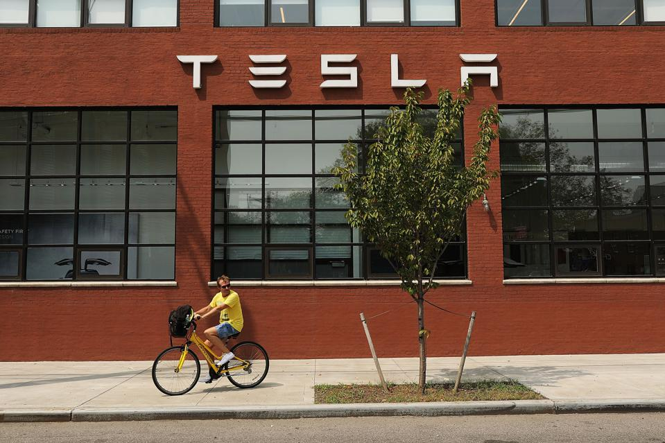 Tesla Shares Slide After Auto Maker Announces That It Will Remain Public
