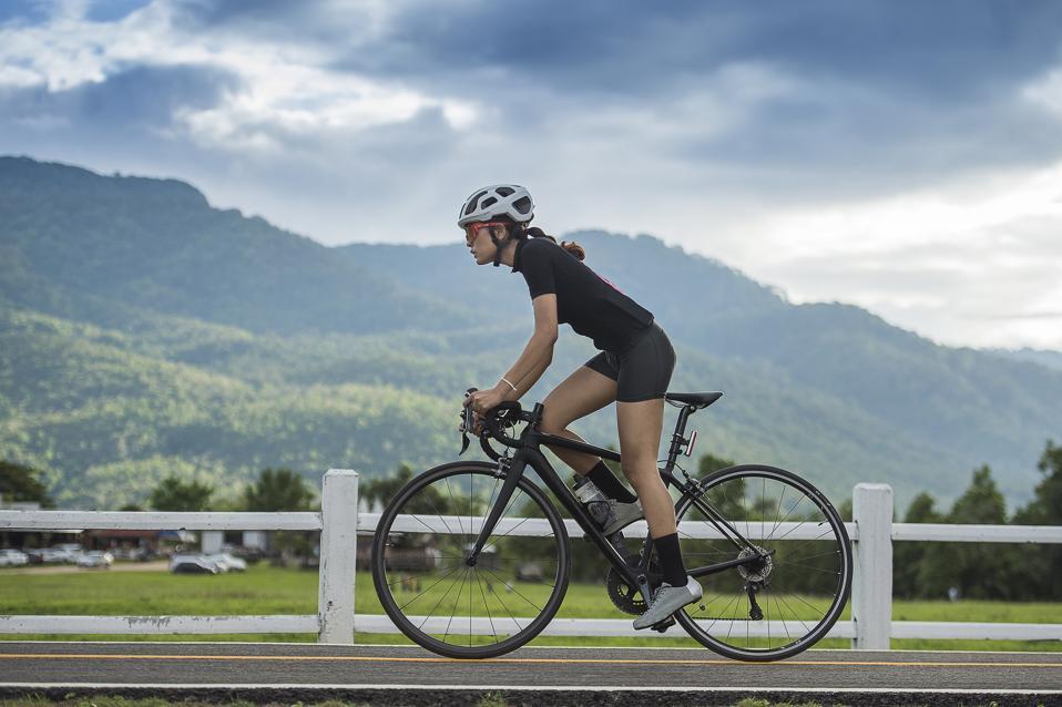 Female cyclist cycling on track