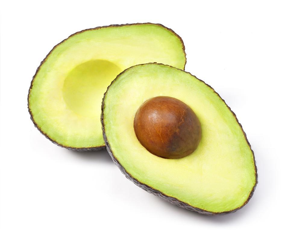 Delicious fresh avocado fruit, isolated on white background