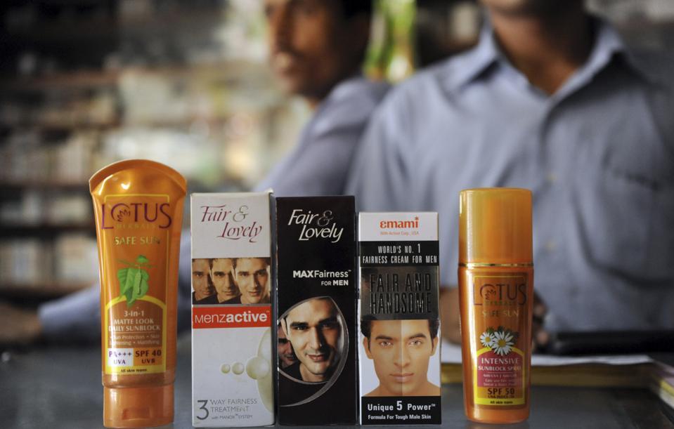 Indian salesman pose with men's fairness