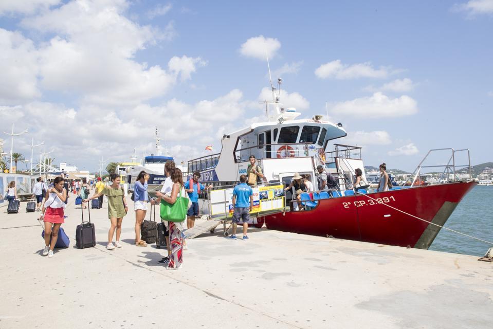 Tourists Enjoy Ibiza Markets And Ferrys