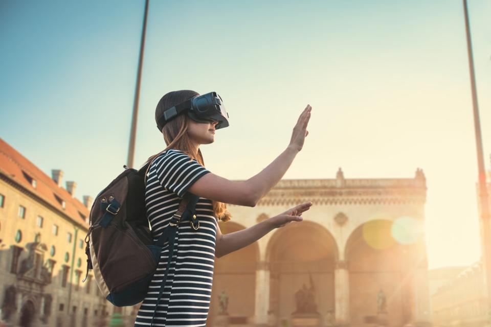 Girl tourist in glasses virtual reality. The concept of virtual tourism