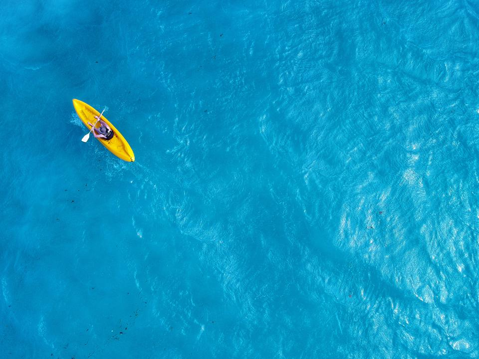 Directly Above Shot Of Man Kayaking In Sea