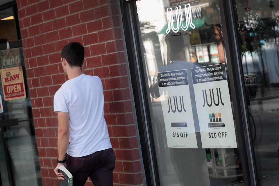 Juul advertising signs in a window.