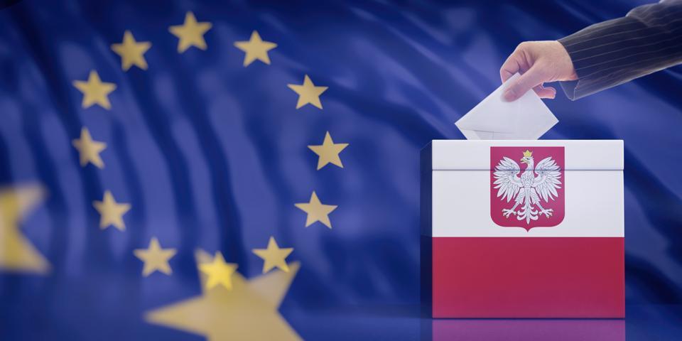 Hand inserting an envelope in a Poland flag ballot box on European Union flag background. 3d illustration