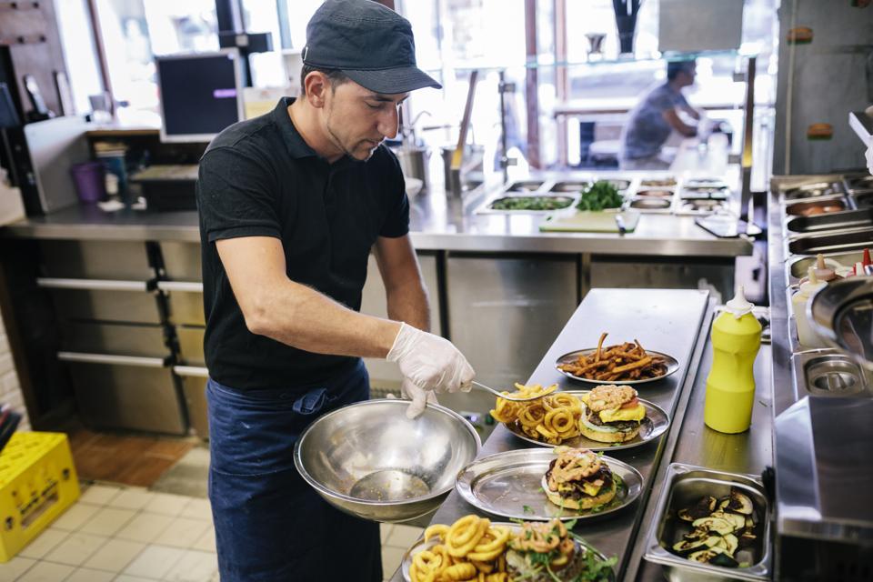 Chef Preparing Gourmet Burgers