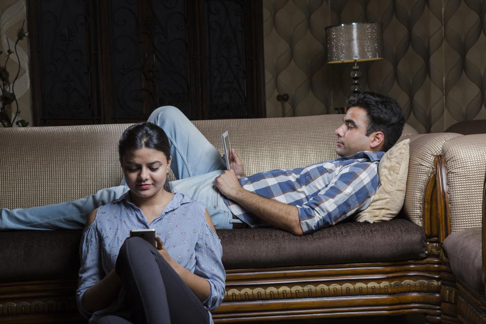 Couple watching media in a tablet - Stock image