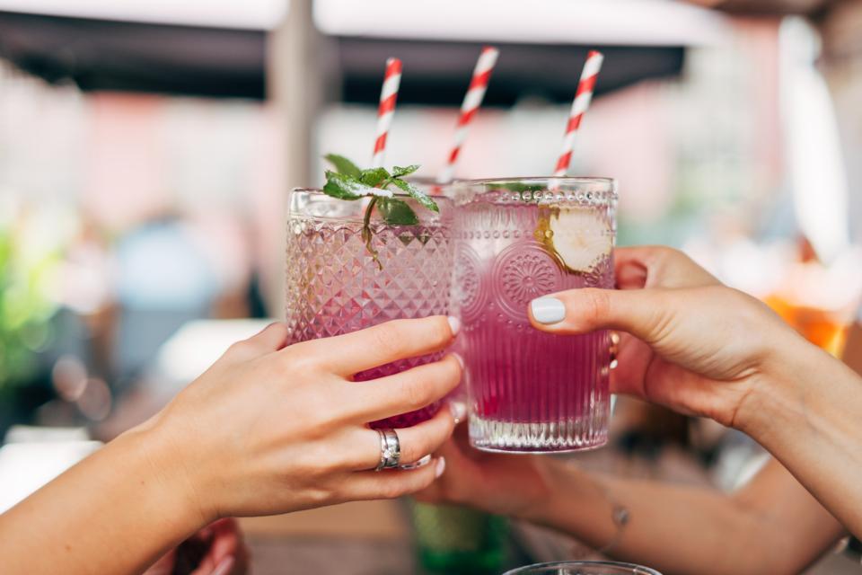 Three women making a celebratory toast