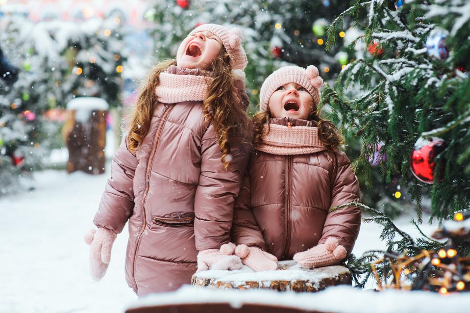 Kids spending Christmas vacations outdoor and traveling