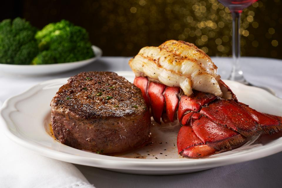 Steak and Lobster on a White Plate and Table Cloth