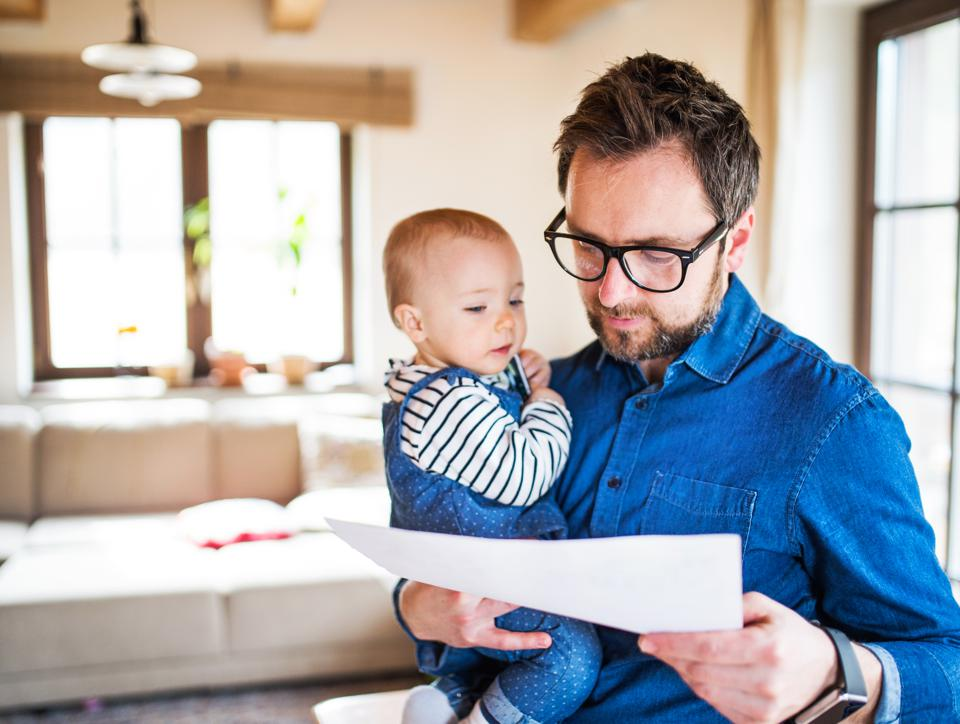 Father working from home with newborn baby on Paternal leave