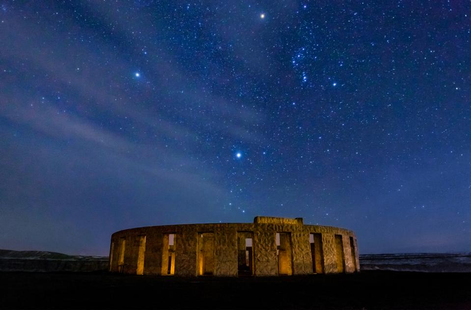 Stonehenge War Memorial at Maryhill at night with stars and Orion constellation–and Sirius the bright star directly above the stones.