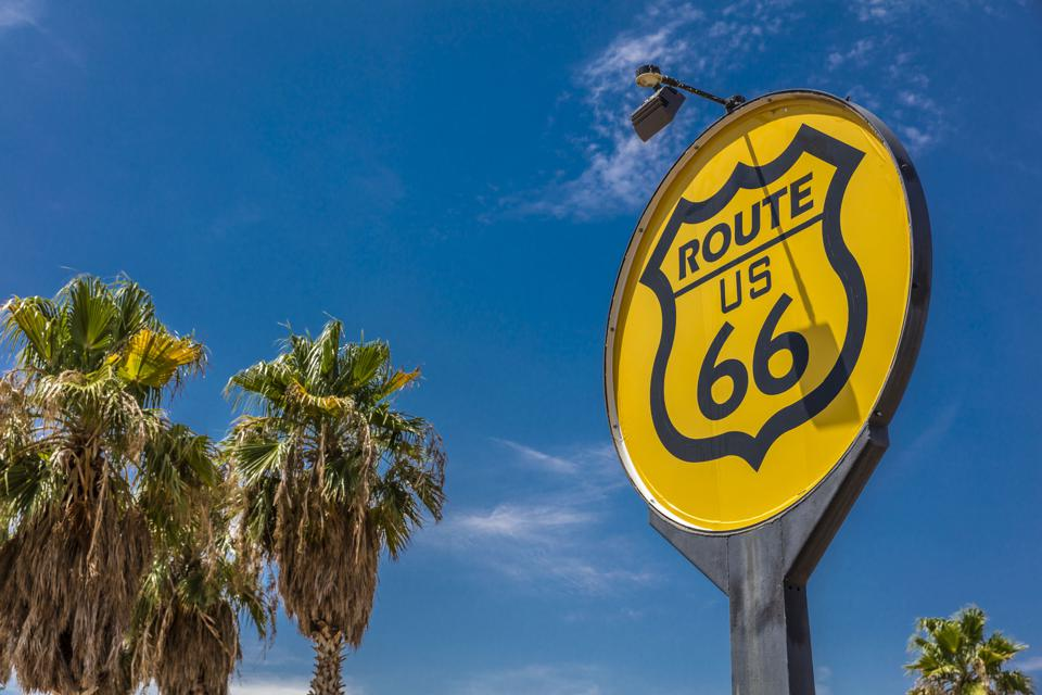 Yellow sign signifies Route US 66, Nostalgia in middle of California Desert