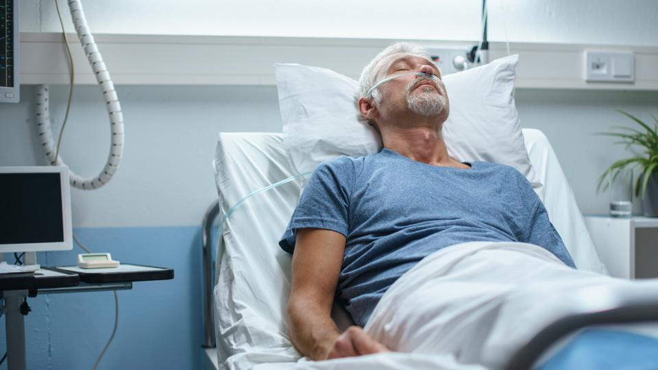 In the Hospital, Senior Patient Lying in Bed, Sleeping. Modern Hospital Geriatrics Ward.