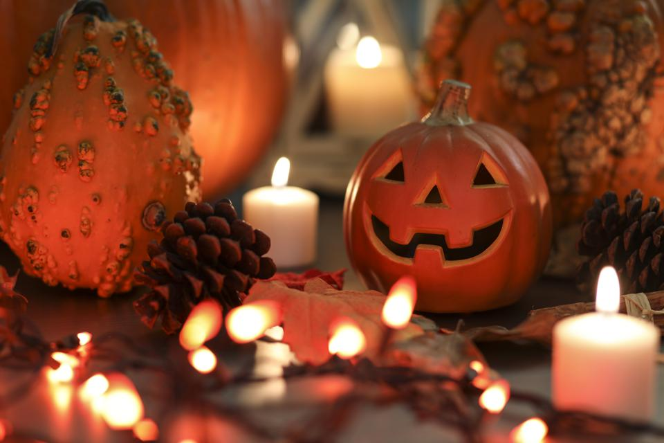 Halloween, autumn scene with pumpkins and candles.