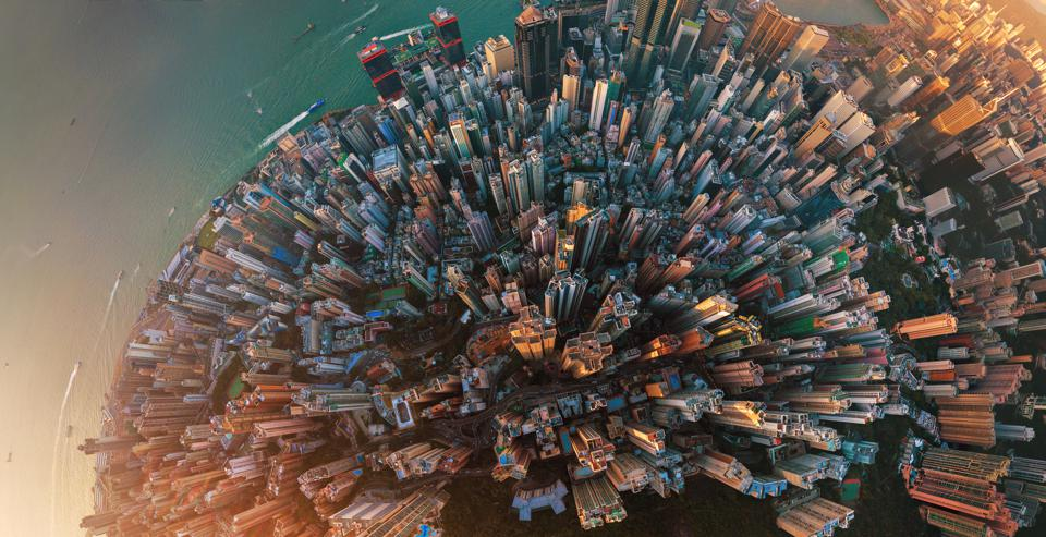 Little planet. Aerial view of Hong Kong Downtown. Financial district and business centers in smart city in Asia. Top view. Panorama of skyscraper and high-rise buildings.