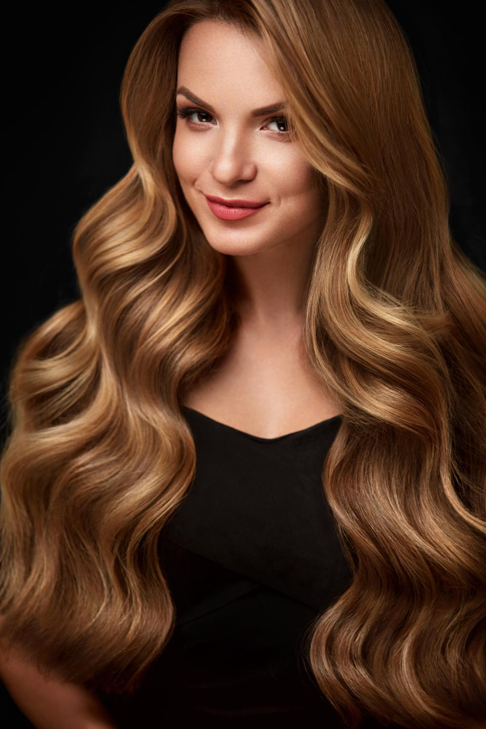 Beauty Hair. Beautiful Woman With Curly Long Blond Hair