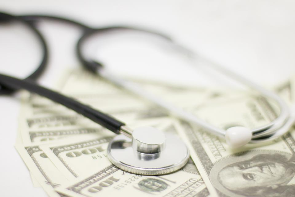 Stethoscope on money - medical concept