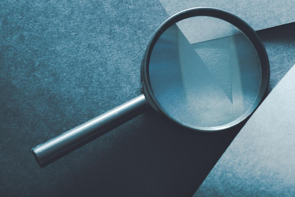 magnifying glass comparison assessment analysis