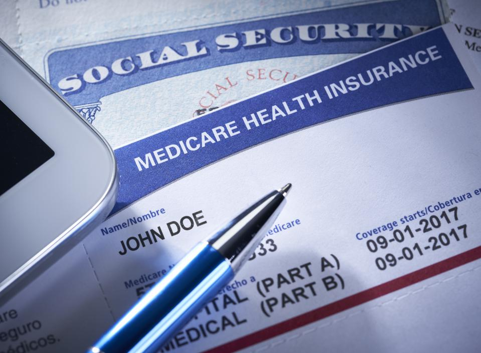 Medicare Health Insurance Card. Social Security Card with Stethoscope and smart phone.