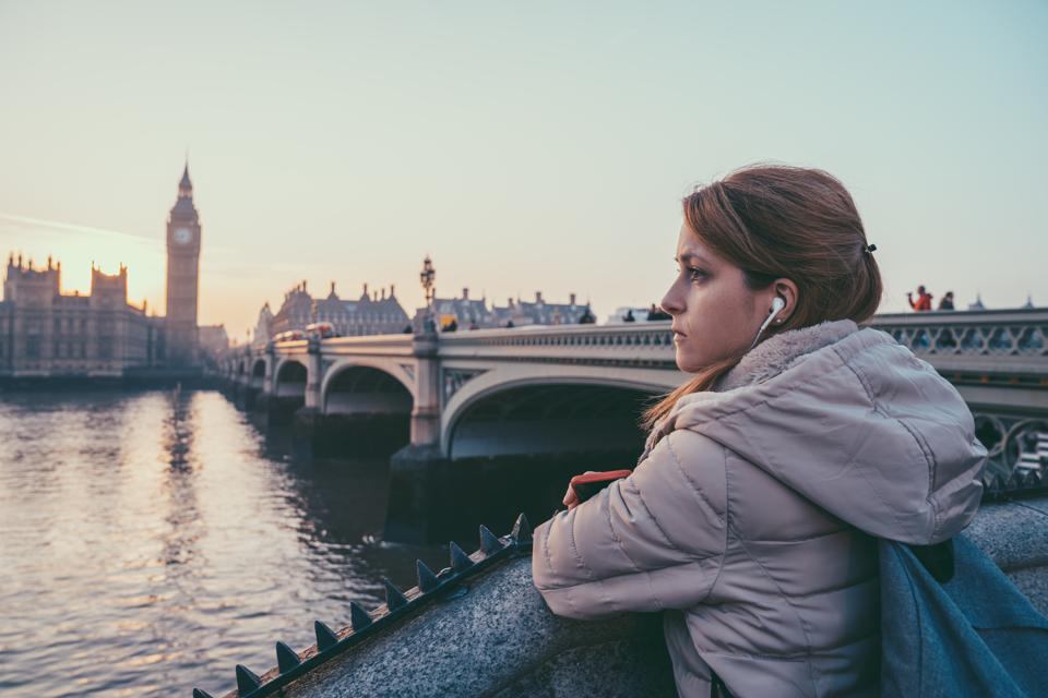 Melancholy woman in London staring the cityscape